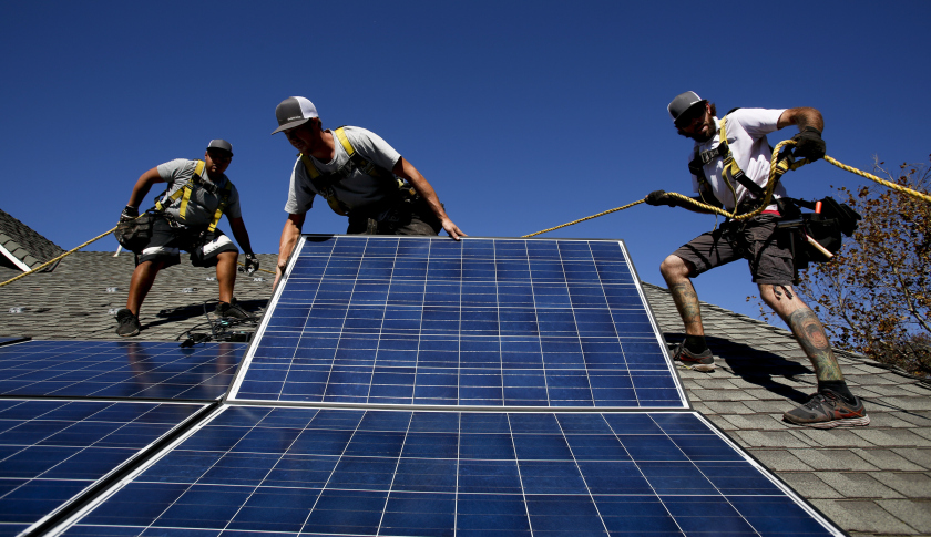 Rogelio Mora (CQ), left, Tyler Smith, center, and Randy Murray, right, workers from vivint.solar in